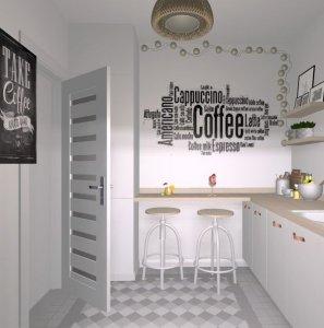 Mała kuchnia z napisami na ścianach